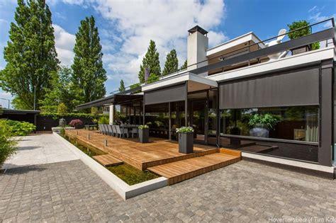 tuin met vijver vlonder en overkapping welnesstuin rotterdam hillegersberg hoveniersbedrijf tim kok