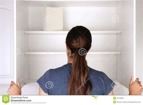 Kitchen Pantry Cabinet Plans Free woman looking in empty pantry royalty free stock photo