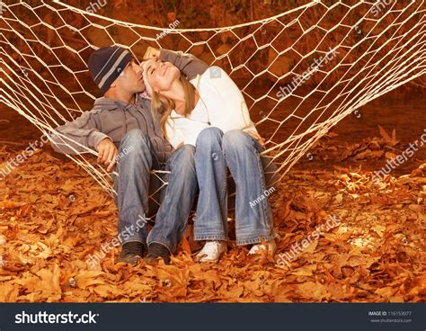 young couple swinging image of happy couple swinging in hammock young family