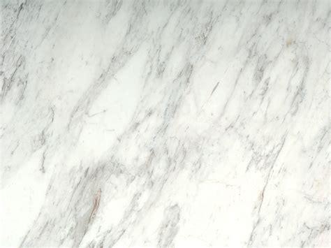 white and gray granite callacatta supreme honed omicron granite tile