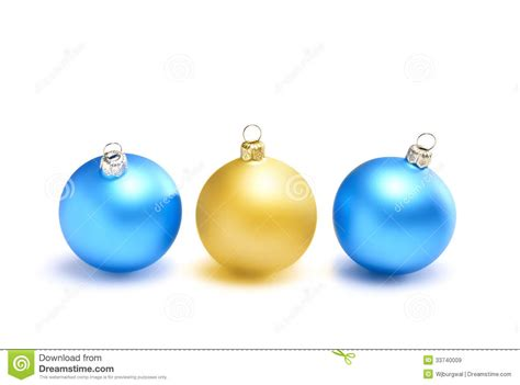 three christmas balls two blue and one yellow royalty free