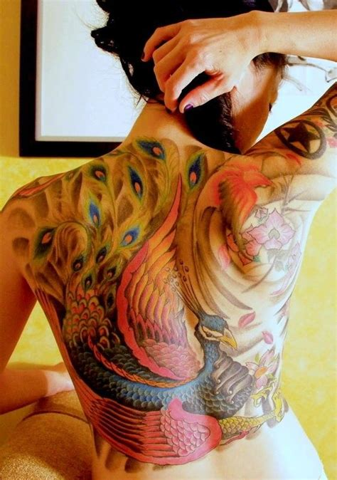 feminine back tattoos bright watercolor on back of peacock with