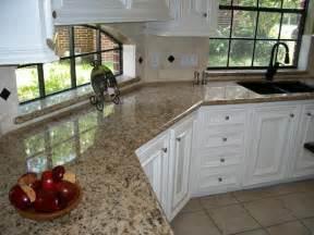giallo napoli granite white cabinets backsplash ideas