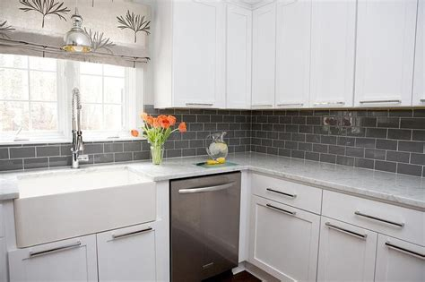 grey kitchen cupboards white backsplash contemporary kitchen features white shaker cabinets paired with grey and white countertops and a