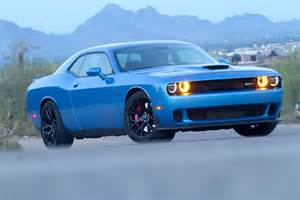 review the dodge hellcat outmuscles the mustang and