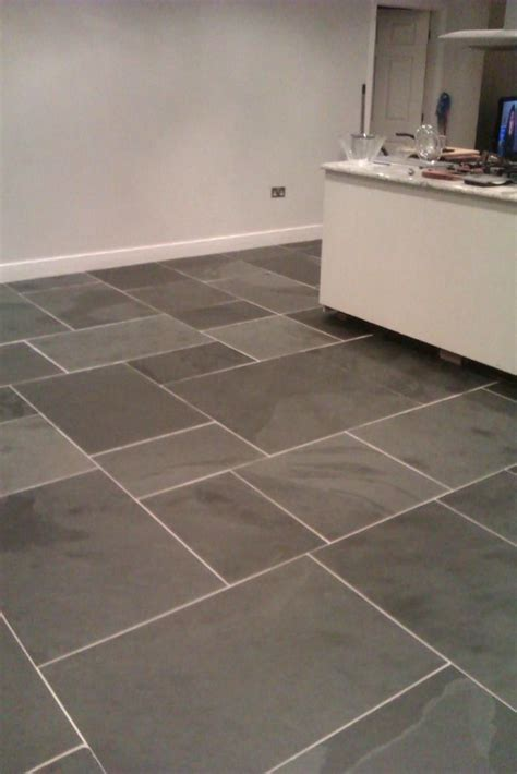 square and rectangle cream tile kitchen floor with white large rectangular clean slate tiles laid on kitchen