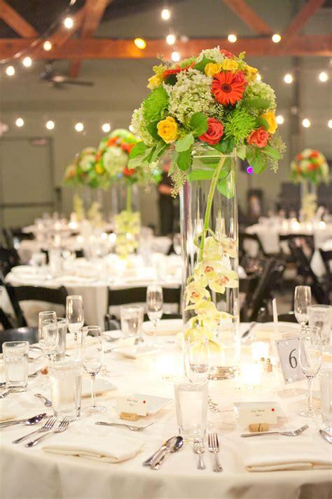 bright wedding centerpiece designed in a glass