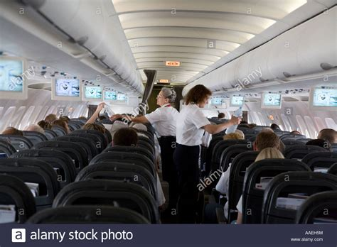Swiss Airlines Interior by Airplane Interior Stewardess Serving Beverages And Food
