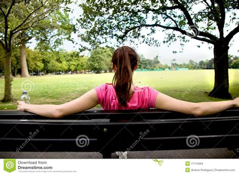 woman sitting on bench woman sitting on a bench stock images image 11714094