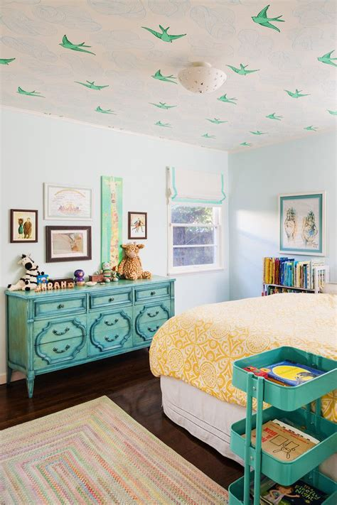 teal kids bedroom bird wallpaper on ceiling teal and yellow colorful rug