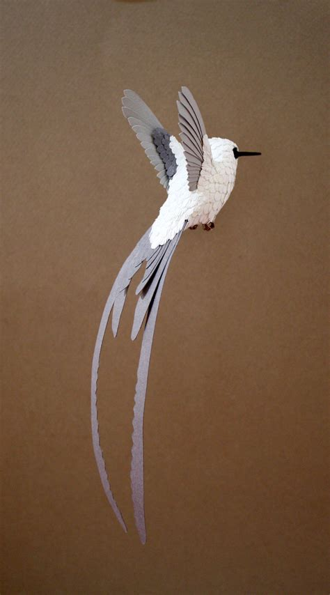 Birds With Paper - i make paper and wood birds by cutting every feather
