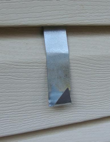 how to hang lights on vinyl siding vinyl or aluminum house siding hook mounting bracket