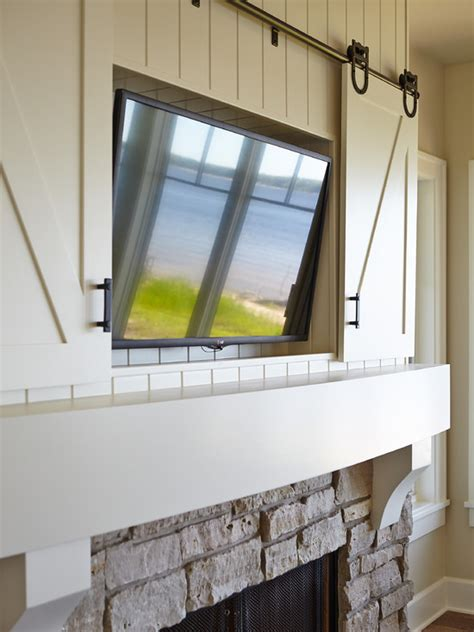 hidden tv in front of window using a nexus 21 tv lift hidden tv over fireplace design ideas