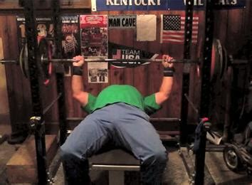 400 bench press most reps bench pressing a 400 pound barbell athlete