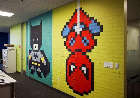 Spiderman Wall Mural office workers install 8 bit superhero mural using 8 024