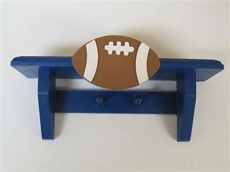 Sport Shelf by Cool Sports Football Wall Shelf With Pegs Hooks