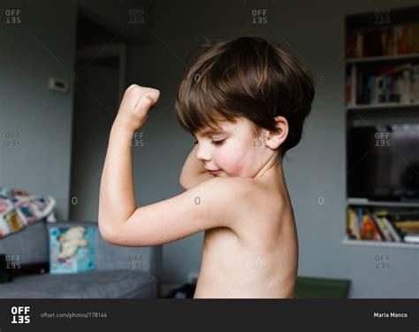 little boy flexing bicep a little boy flexing his muscles stock photo offset