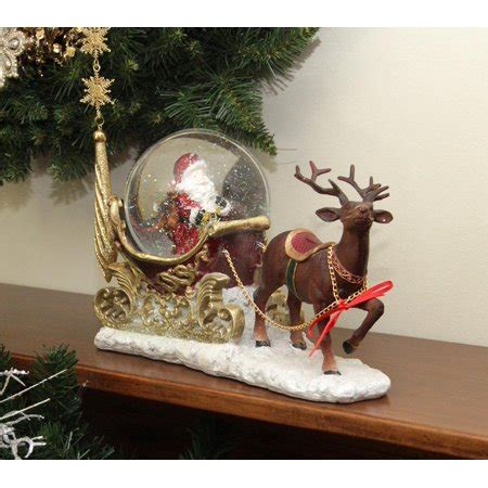 santa ckaus with snow decoration 12 quot santa claus sleigh and reindeer glitterdome snow globe table top figure walmart