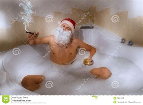 santa in the bathtub santa with whisky and cigar sitting in bath tub stock