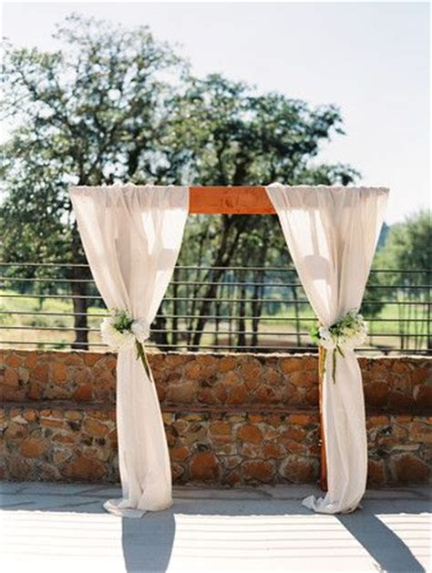 Wedding Arbor Fabric by Wedding Arbor Draped With Fabric And Flower Arrangements