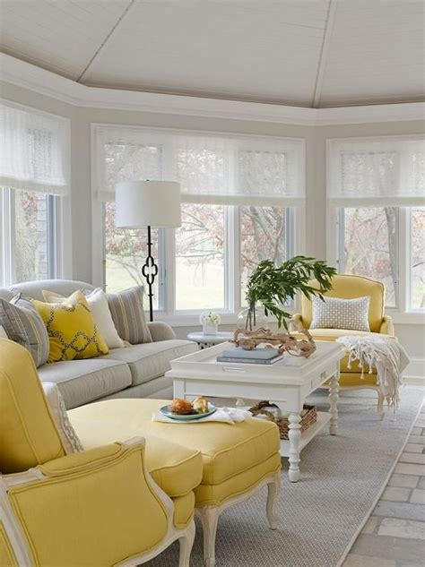 grey and yellow sofa yellow and gray sunroom features a gray roll arm sofa