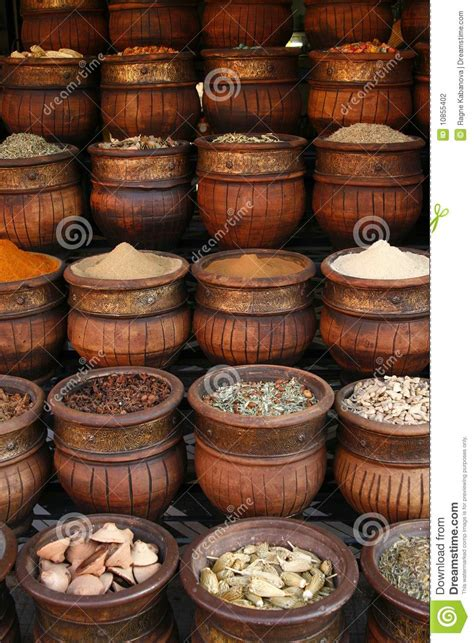 Handmade Pots - carved handmade pots of spices morocco stock photo