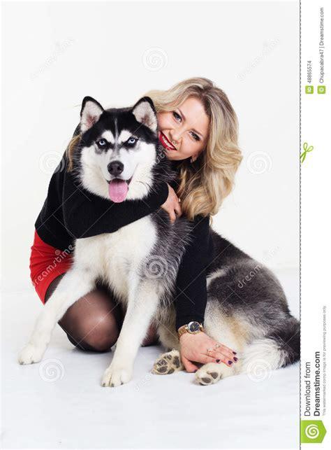 young girl   husky dog  white stock photo image