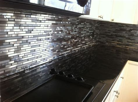 glass and marble backsplash glass and swirled metal backsplash installed by stepping
