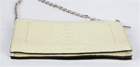 Ck Fendi Jour By Honshop calvin klein collection 1595 yellow snakeskin clutch