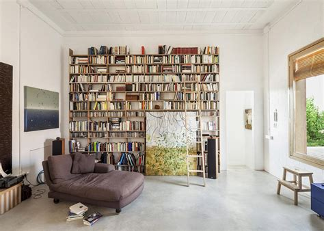 reading space house of three brick boxes and outdoor living rooms between modern house designs