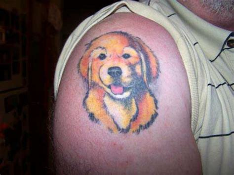 cute butt tattoos a golden retriever puppy grins out of this