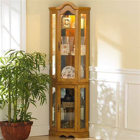lighted curio cabinet oak southern enterprises dahley golden oak lighted corner