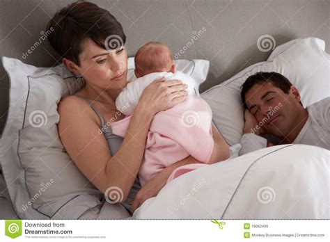 How To Cuddle With A In Bed by Cuddling Newborn Baby In Bed At Home Royalty Free Stock Images Image 19062499
