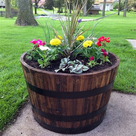 Planter Ideas Sun by 17 Best Ideas About Whiskey Barrel Planter On