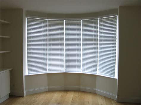 Blinds For Bow Windows 50mm white woodslat blinds in bay window hampstead north