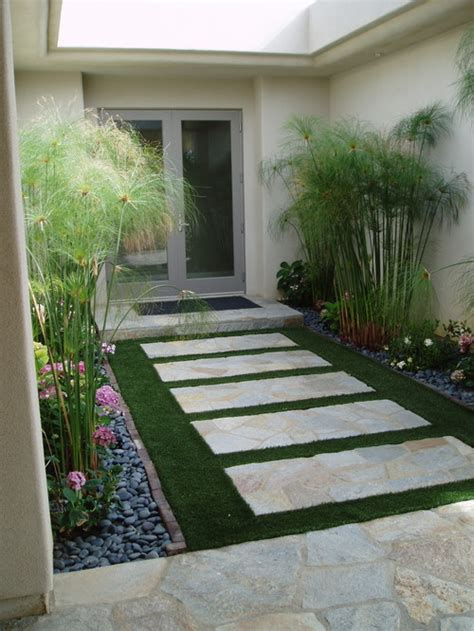 artificial grass patio what is that bamboo like plant is that artificial grass