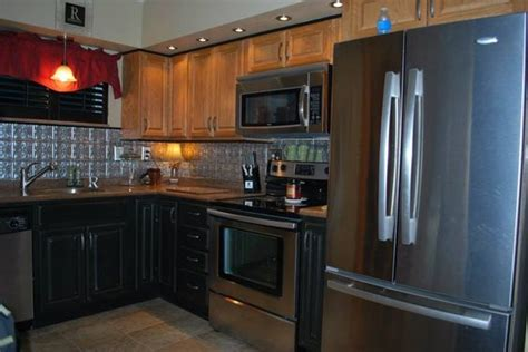 black stainless steel and solid surface countertops on