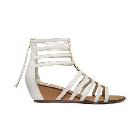gladiator wedge sandals lyst report megan gladiator wedge sandals in white