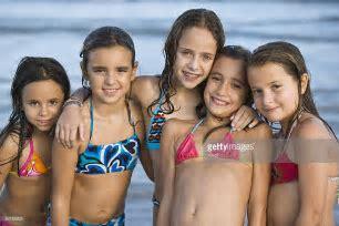 Hispanic Girls In Bikinis Posing On Beach Stock Photo Getty Images