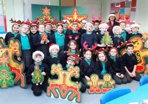 sainsbury s donates christmas decorations to local school