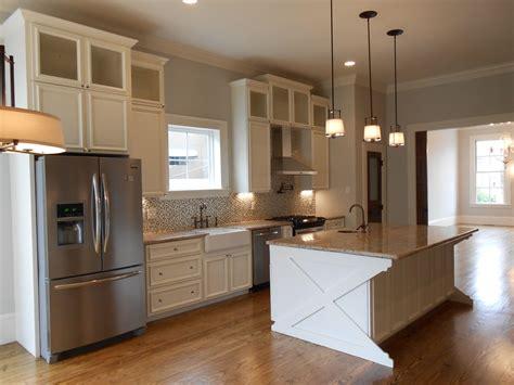 custom designed  built cabinets glass front upper