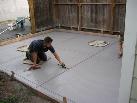 how much does it cost to put concrete in backyard how much does a concrete driveway cost here s how to