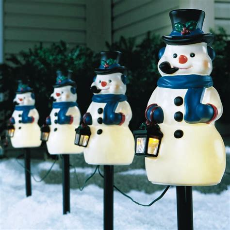 holiday time 4 piece vintage snowman pathway christmas lighted lawn stakes set celebrations vintage look snowman pathway marker 4 pack 78709 71 outdoor and window d 233 cor