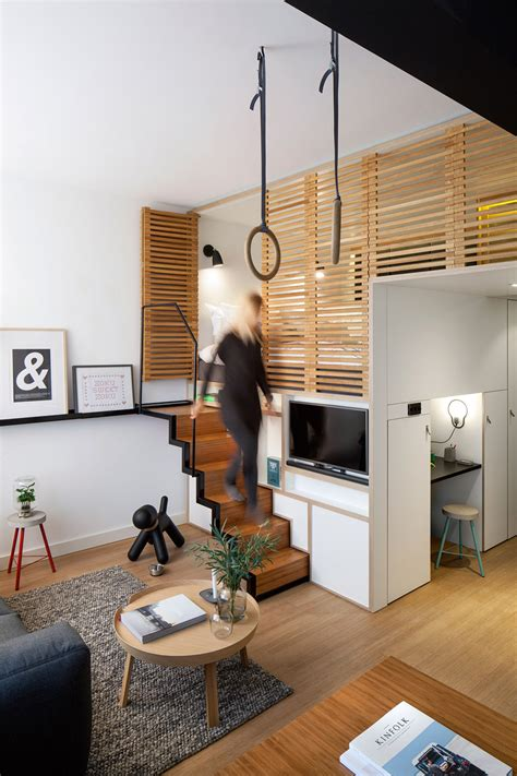 the room loft hotel room boasts retractable staircase and hideaway loft bed living in a shoebox