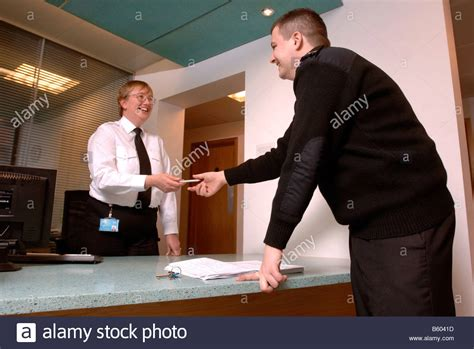 Desk Safety Officer by A Security Guard On Patrol Signs In At A Front Desk With