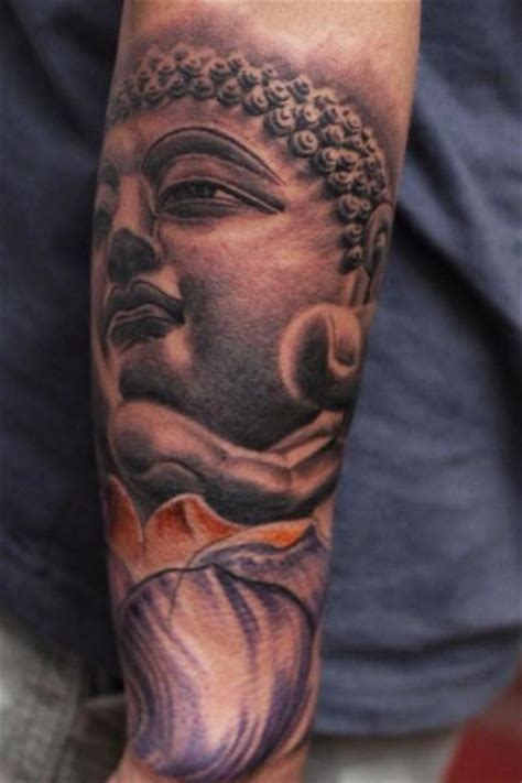 arm buddha tattoo by ryan bernardino