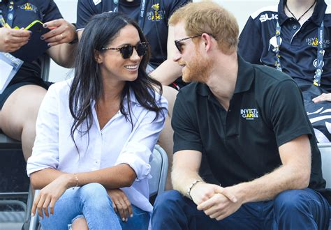 meghan harry prince harry and meghan markle hold hands at invictus games