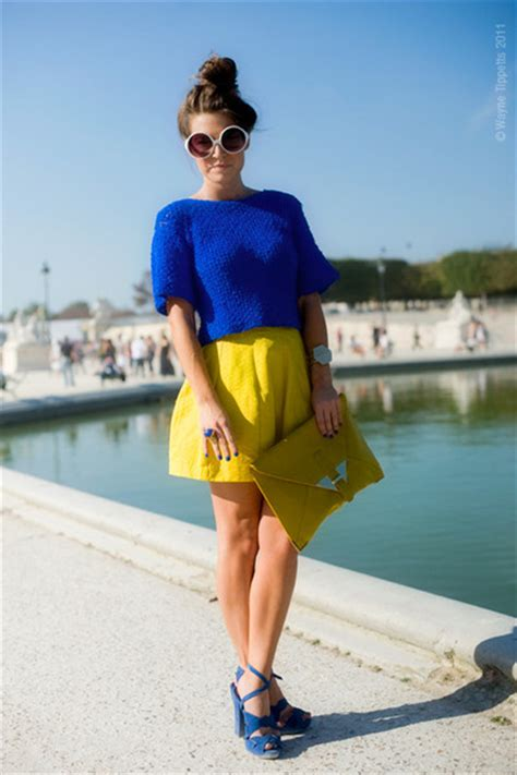yellow bags blue shoes white sunglasses yellow skirts