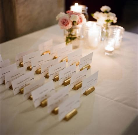 Sprei My Wedding spray painted wine corks to hold table assignments my
