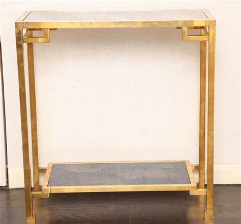 Small Glass Console Table A Small Geometric Two Tier Brass And Antique Glass Console Table At 1stdibs